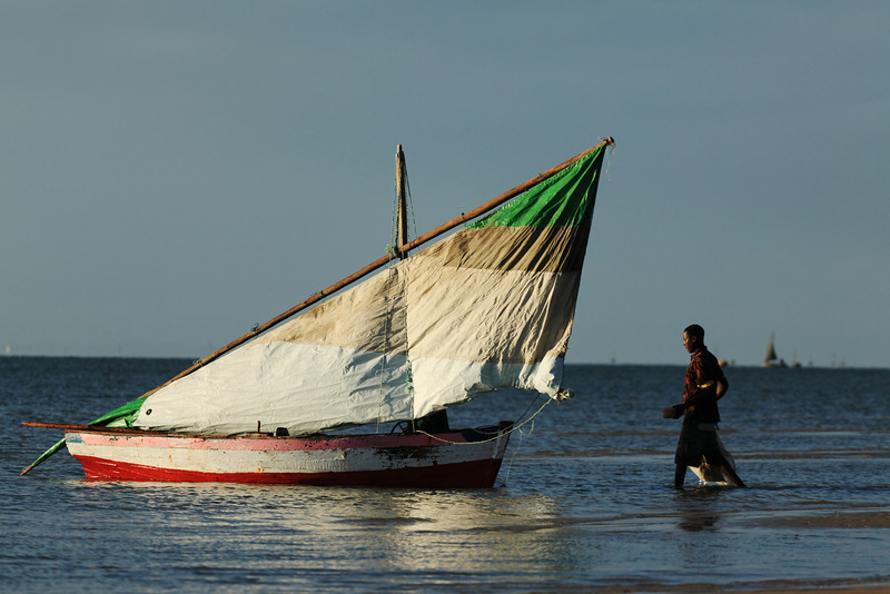 Fishermen and its dhow from Vilankulos, close to the Bazarutos islands, Mozambique.
