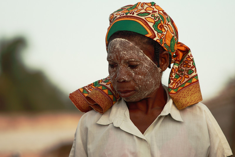 Woman with traditional make-up at Ilha de Mozambique, Mozambique.