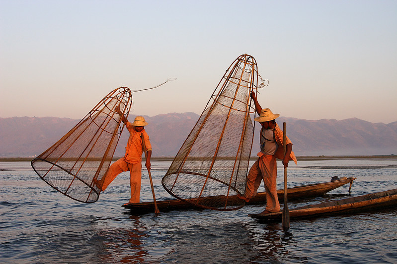 Graceful Inthas fishermen, Inle lake, Myanmar.