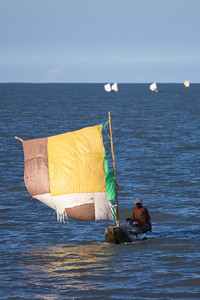 Small boats with sail made of sugar bag, Beira, Mozambique.